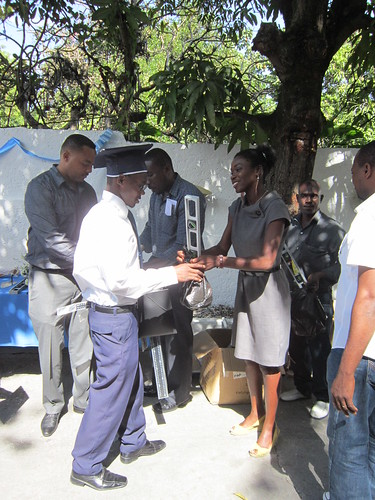 AFSC-Haiti's Sonide Simon hands the new graduates toolkits which are meant to support them in their future work