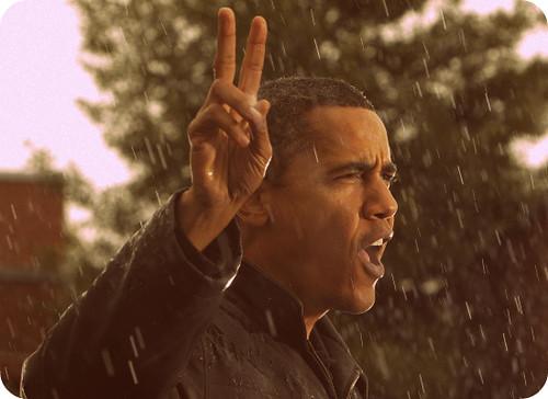 Barack Obama met twee vingers in de lucht