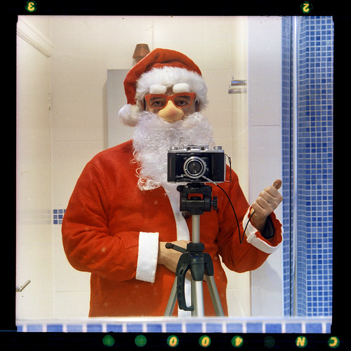 Ho ho ho - reflected self-portrait with Ensign Selfix 820 Special camera and santa suit by pho-Tony