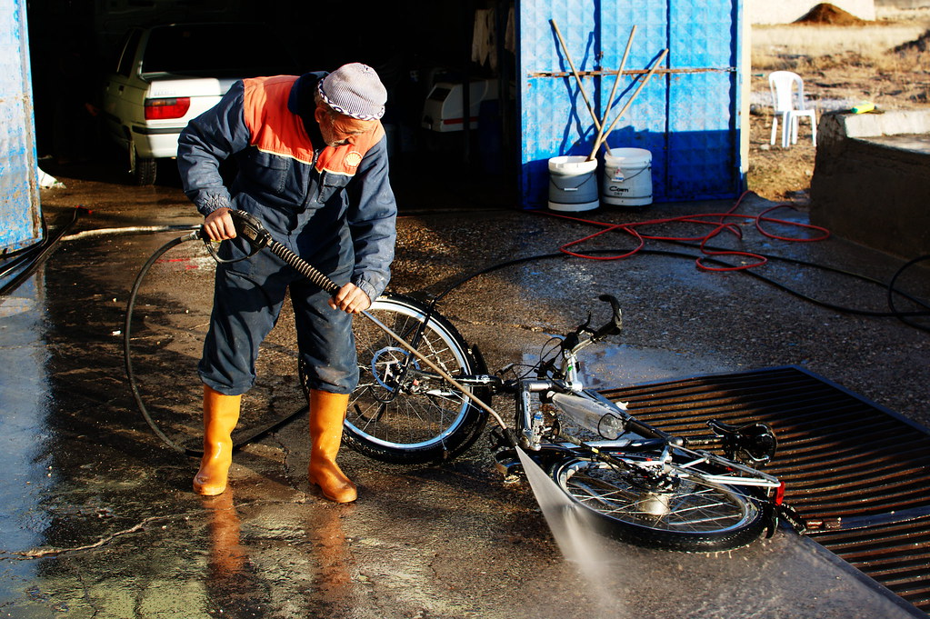 cleaning the muddy bike