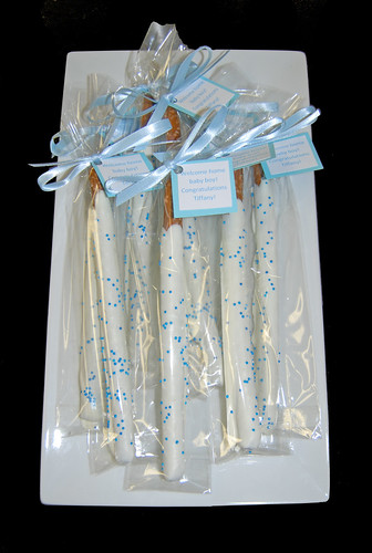 blue and white chocolate dipped pretzel baby shower favors