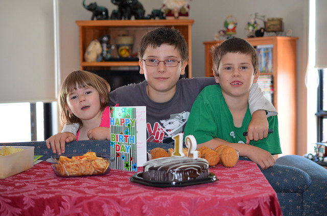 Joshua celebrates his 12th birthday with Karla and Bradley.