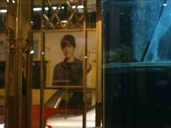Bieber on Bus in HK spotted through North Point restaurant door