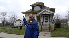 Gloria Lowe in front of her home in East Detroit