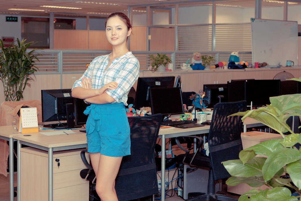 Hot office worker with long legs.