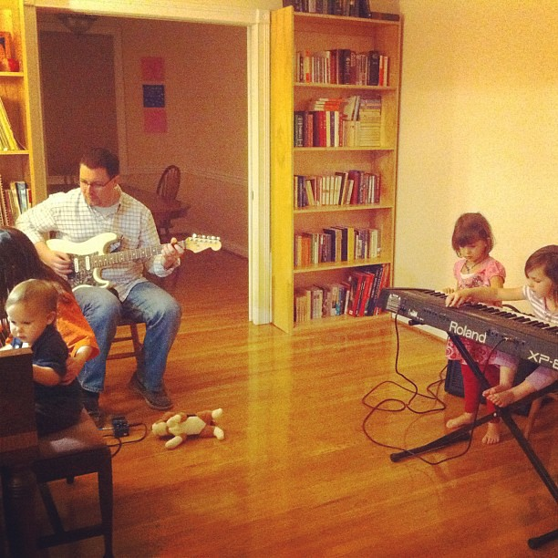 "Husband on electric guitar, little girls on keyboard, biggest and baby on piano. 10yo neighbors comment ""you must be lucky to have all this."" Yes, yes I am. :)"