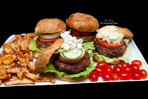 Platter of Pat LaFrieda's Original Blend and Shortrib Blend Burgers with homemade baked spiced fries