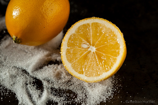 Cut in half meyer lemon in a pile of sugar