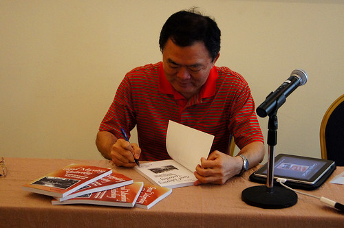 Autographing our copies