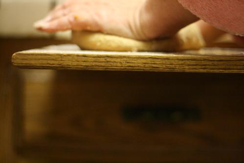 kneading pumpkin roll dough.