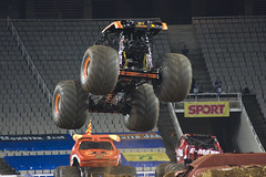 freestyle motocross(0.0), pit stop(0.0), formula one(0.0), screenshot(0.0), race track(0.0), auto racing(1.0), automobile(1.0), racing(1.0), sport venue(1.0), vehicle(1.0), sports(1.0), open-wheel car(1.0), motorsport(1.0), monster truck(1.0), stunt performer(1.0),
