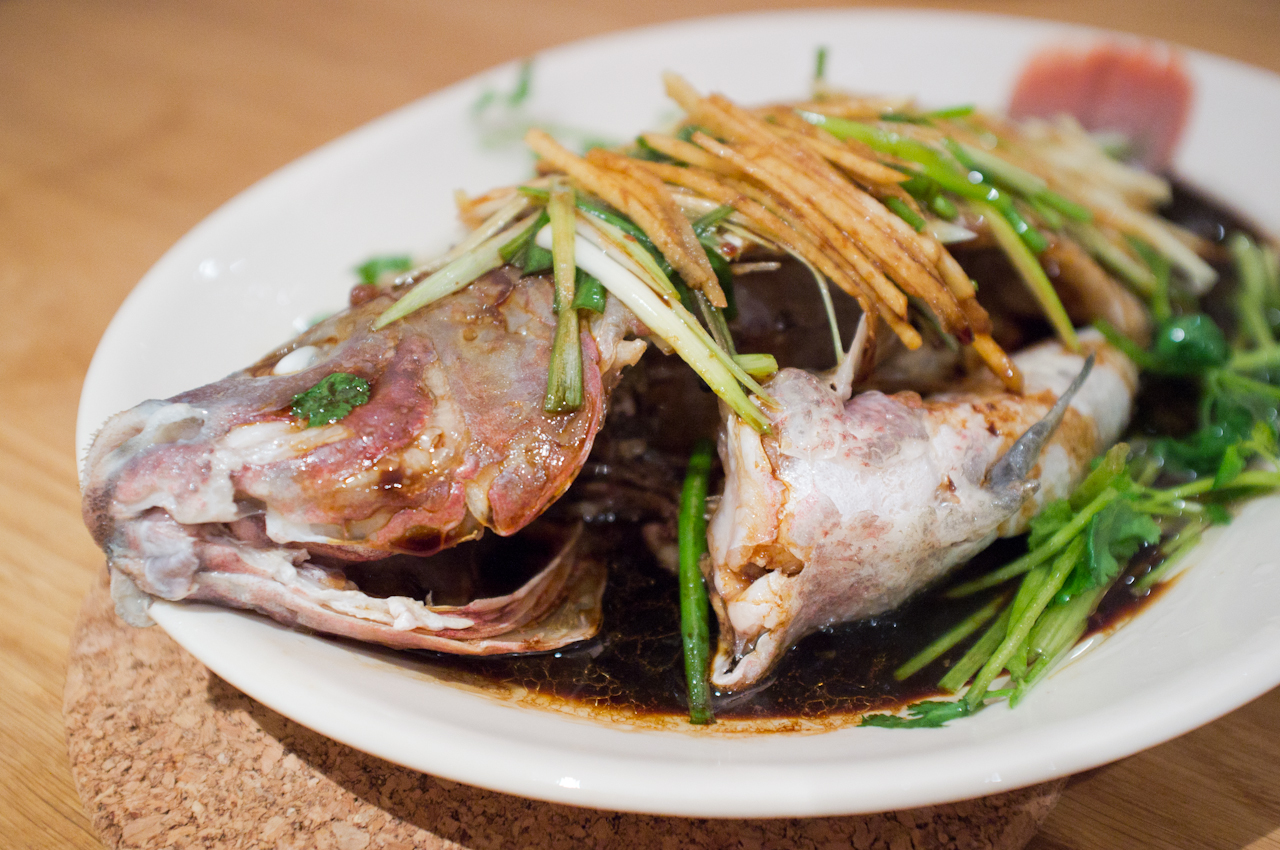 Steamed whole fish with ginger, scallions, cilantro and soy