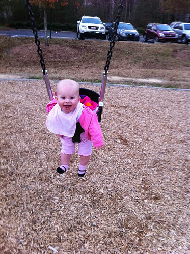 Lucy loves the swing.