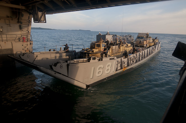 A LCU assigned to ACU-5 enters the well deck of USS New Orleans