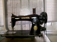 sewing machine(1.0), machine(1.0), iron(1.0), home appliance(1.0),