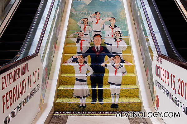 A promotional ad for the musical on the stairs at Maxims Tower