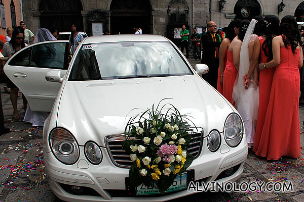 As one couple leaves, another bride arrives