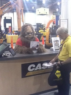 Sasquatch working at the Case booth