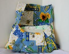 furniture(0.0), bed sheet(0.0), pillow(0.0), throw pillow(0.0), cushion(0.0), art(1.0), pattern(1.0), textile(1.0), patchwork(1.0), yellow(1.0), design(1.0), blue(1.0),
