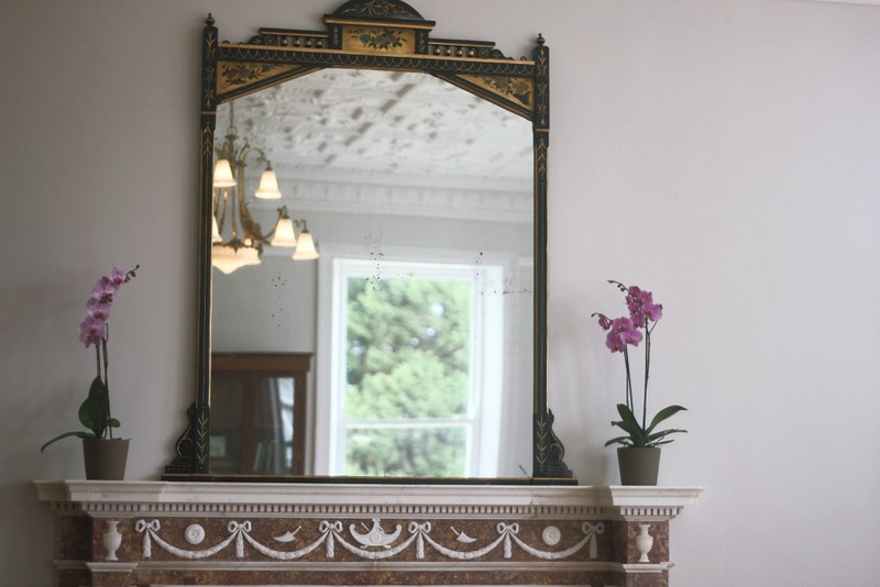mirror on mantelpiece airfield house