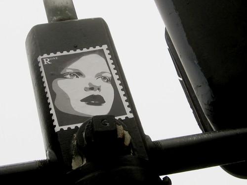 Urban Art: Stencil Woman on Traffic Light Post