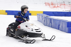 sledding(0.0), auto racing(1.0), racing(1.0), winter sport(1.0), vehicle(1.0), sports(1.0), motorsport(1.0), snowmobile(1.0), land vehicle(1.0), sled(1.0),