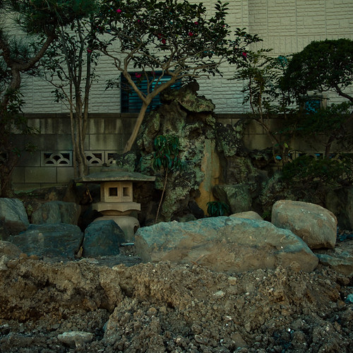 Bulldozed Lot with Japanese Lantern and Rock Garden