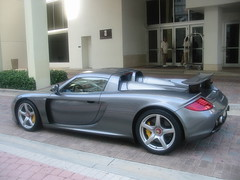 automobile(1.0), automotive exterior(1.0), wheel(1.0), vehicle(1.0), automotive design(1.0), bumper(1.0), porsche carrera gt(1.0), land vehicle(1.0), luxury vehicle(1.0), supercar(1.0), sports car(1.0),