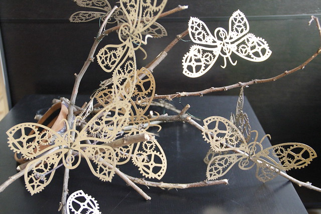 Laser cut butterflies with gears as a hat!