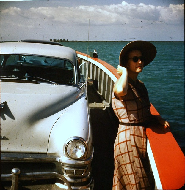 Lady With Hat And Chrysler On A Ferry