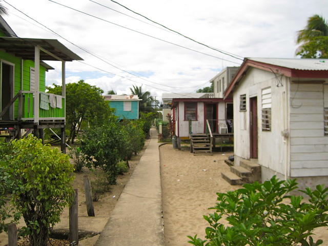 narrow main street and sidewalks of placencia belize