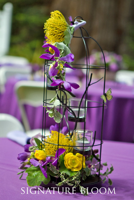whimsical or vintage wedding use floral birdcages as your centerpieces