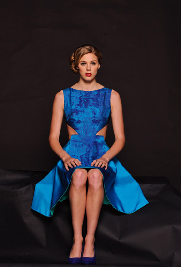 Blue Open-Backed Silk Couture dress, seated on black background. Photography by Kent Johnson