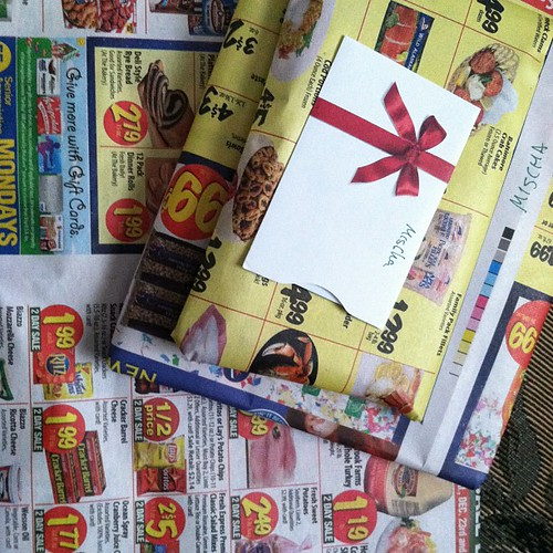 Supermarket circular as wrapping paper