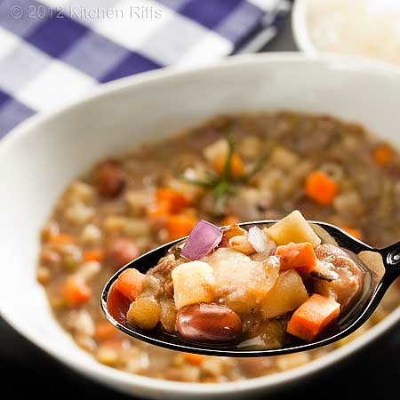 Tuscan Bean and Pasta Soup, Close-up of soup in spoon with bowl of soup in background