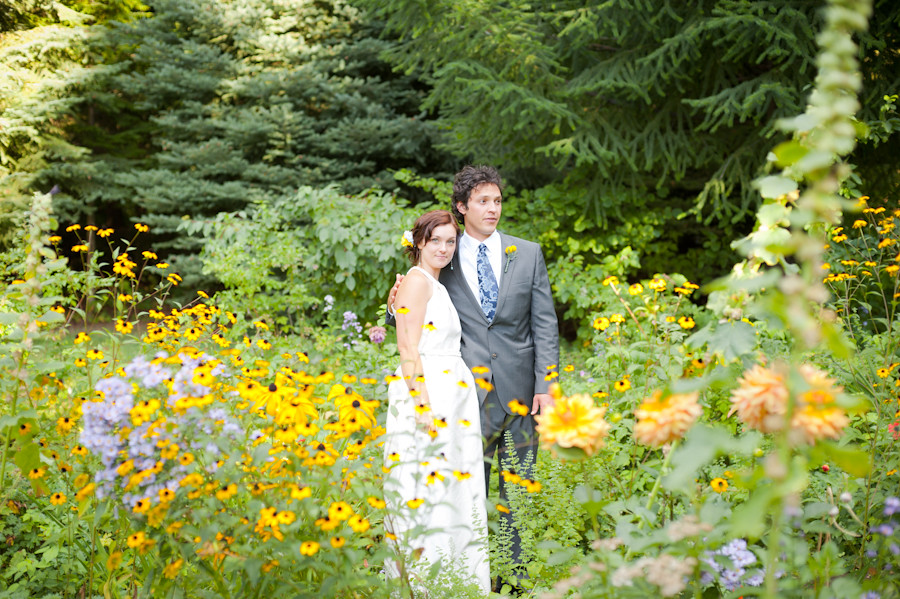 Married couple standing in a field of wildflowers at Mt. Hood Organic Farms