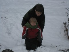 Baby tries playing in the snow