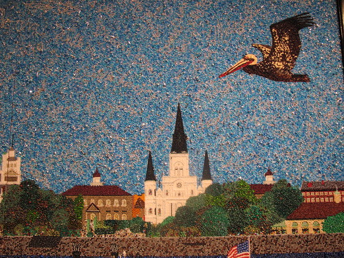 Wanger specializes in Mardi Gras beaded art, that displays Louisiana slices of life, like the above pelican flying over the St. Louis Cathedral. Photo by Briana Prevost