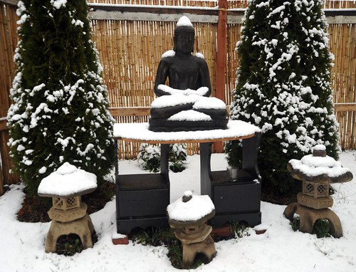 Snow Buddha, outdoor shrine, Japanese stone lanterns, trees, bamboo fence, Seattle, Washington, USA by Wonderlane