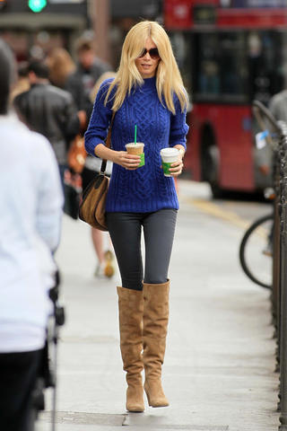 Claudia Schiffer in knee-high boots