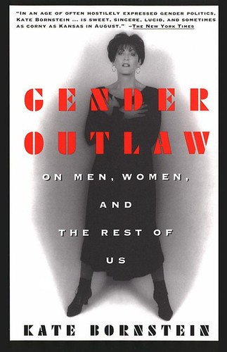 "The book cover of Kate Bornstein's ""Gender Outlaw: On Men, Women, and the Rest of Us"" showing Bornstein standing with folded arms"