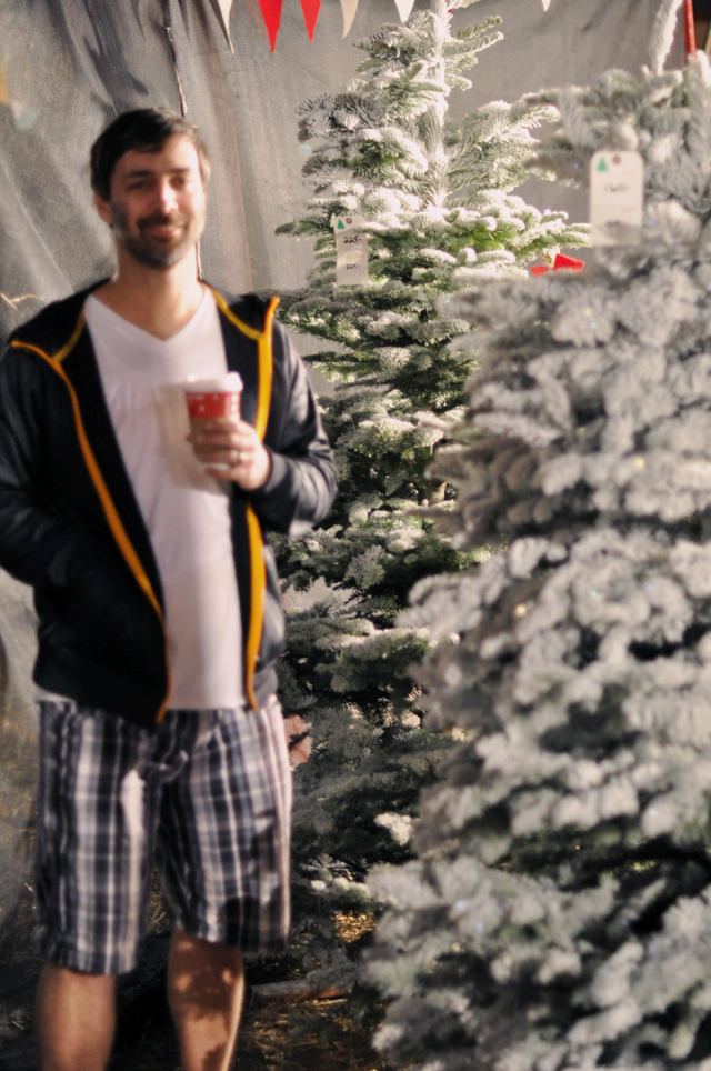 in shorts buying a christmas tree in california