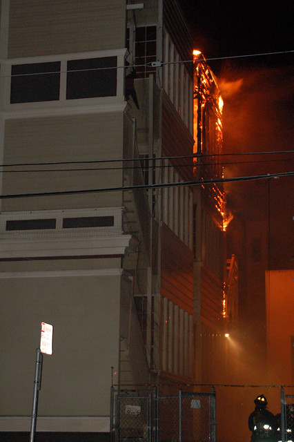 2fireman looks up at burning porch.jpg