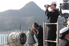 SASEBO, Japan (Dec. 8, 2011) Sailors aboard the forward-deployed amphibious assault ship USS Essex (LHD 2) stand the forward lookout watch as the ship returns to Sasebo following a two and a half month patrol of the western Pacific region. (U.S. Navy photo by Mass Communication Specialist 2nd Class William Jenkins)