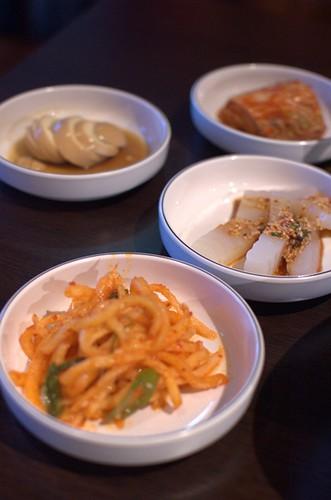 Egg in soy sauce, cabbage kimchi, mung bean jelly, daikon kimchi