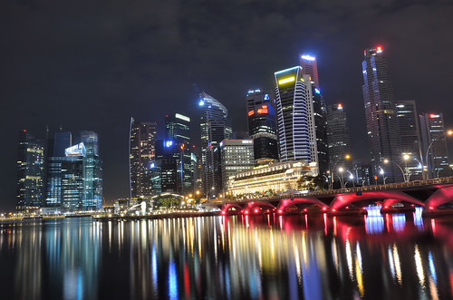 Singapore skyline and bridge at night