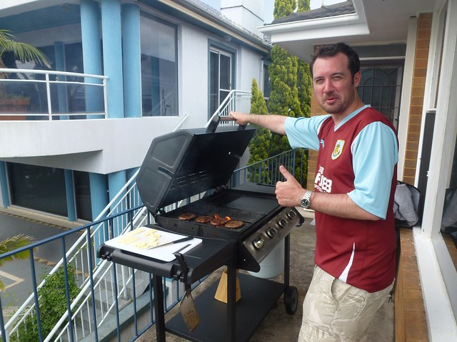 Al in his Burnley shirt cooking lunch