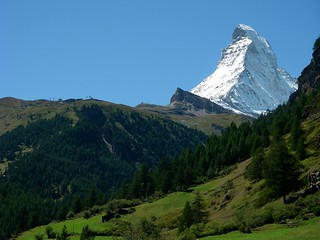 A snow covered Matterhorn (4478 metres) standing above the alpine pastures