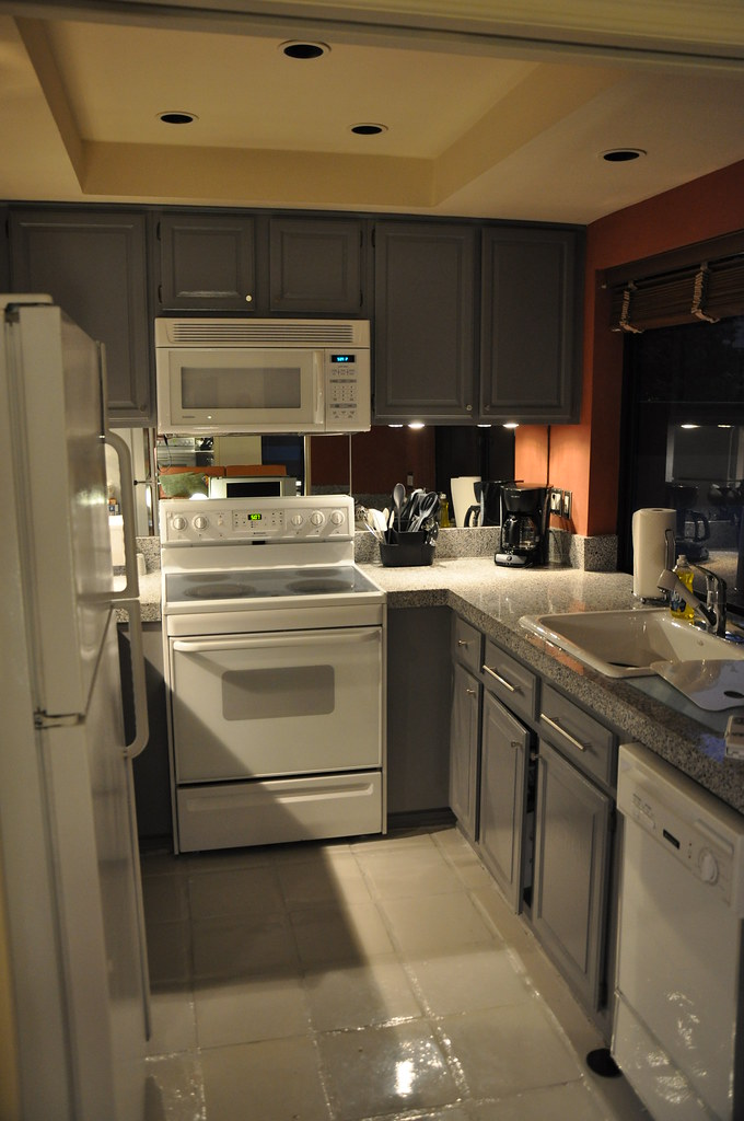 Kitchen Electrical Appliances : Galley kitchen includes refrigerator, microwave, electric range ...