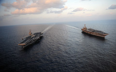 ARABIAN SEA, (Jan 19, 2012) The aircraft carriers USS Abraham Lincoln (CVN 72) and USS John C. Stennis (CVN 74) join for a turnover of responsibility in the Arabian Sea. Stennis returned to the 7th Fleet Jan. 19 after Lincoln assumed responsibilities in 5th Fleet. (U.S. Navy photo by Mass Communication Specialist 2nd Class Colby K. Neal)